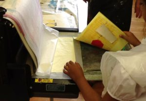 A young person explores printmaking in a previous Treasure Group project.