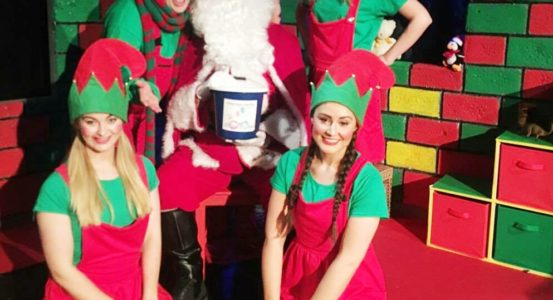 SANTA'S NAUGHTY ELF SHOWS HIS GOOD SIDE FOR CHARITY
